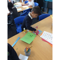 Hadi working hard in our creative area!
