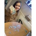 Elisa working hard on her maths money problems!
