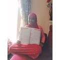 Rahma has been doing school work with her sister.