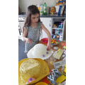 Faye busy decorating her Easter Bonnet