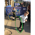 Using our whole body to spin the hoop