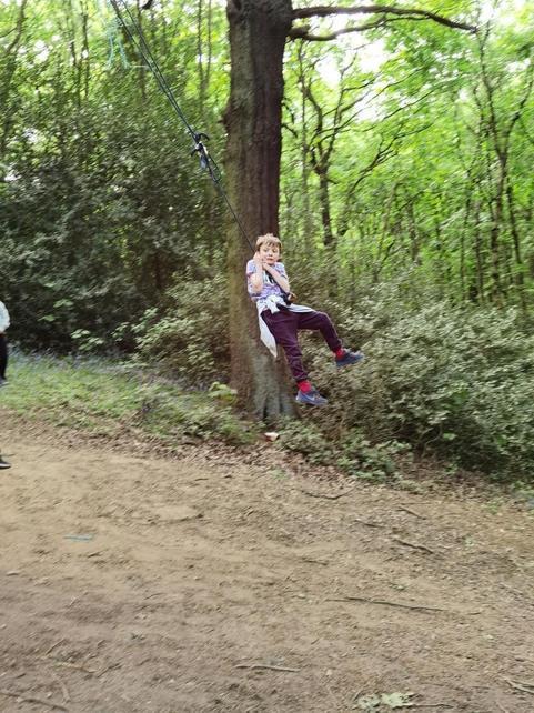 Kaid playing Tarzan in the woods