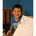Darian enjoying his maths work