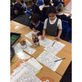 Sidra and Yara colouring animals by number!