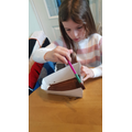 Making a pirate ship from her Easter egg box!