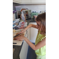 Faye making a sandwich, cutting carefully :)