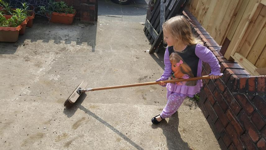 Sweeping the patio.