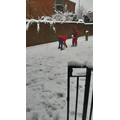 Joshua and his brother having fun in the snow