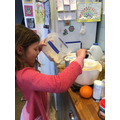 Nadia baking muffins - good maths learning!