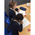 Elsie and Avneet concentrating hard on their work!
