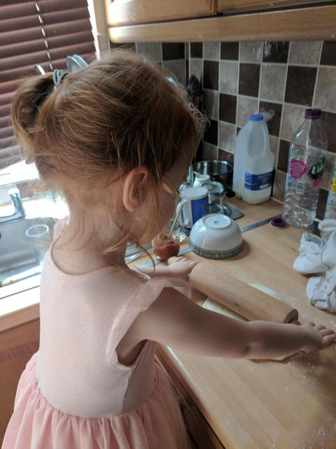 Lena helping her mum at home