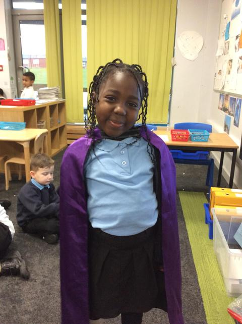 Jamila helped tidy up in Elm with another child.