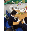 Levi and Husna at the animal art table!
