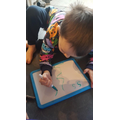 In phonics, we explored 's'. Luke had a go at writing 's'.