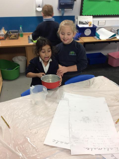 Working together to empty their 2 litres!