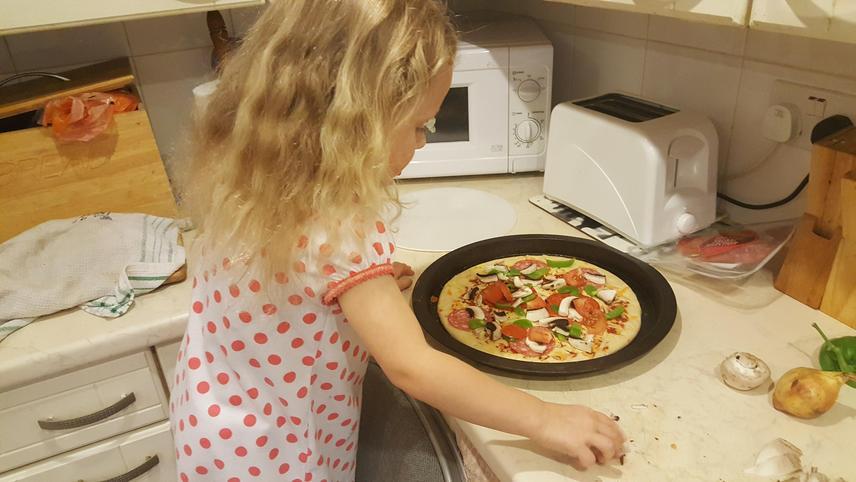 Helping Mummy make pizza, yummy!