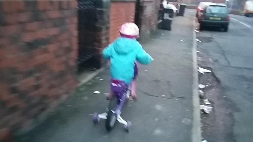 Jade riding her bike