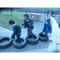 We lift heavy tyres to make courses.