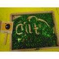 mark making in green glitter