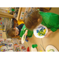 using yellow and blue paint we coloured mixed to make green using a paper clip and magnet