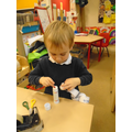 making paper chain snowmen