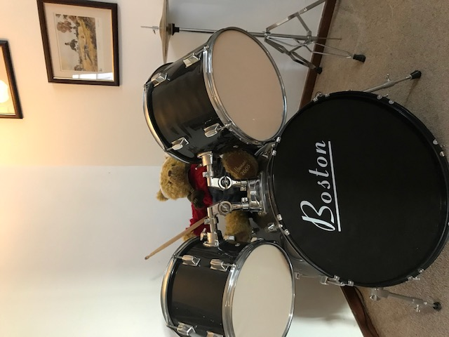 Andy has been learning to play the drums