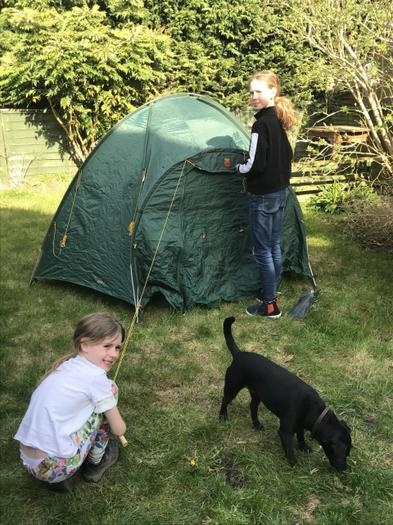 Alison helping to set up the tent for camping