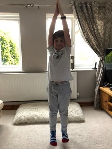 Arlen stretching as tall as he can,