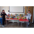 Our Head boy and Head girl with some of the donated items