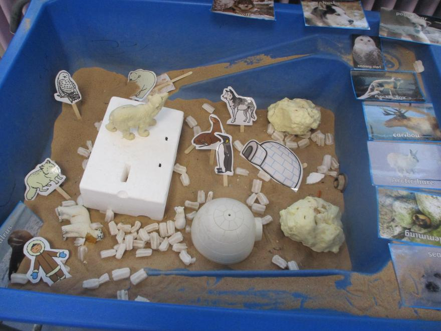 North Pole Small World - building igloos in the sand
