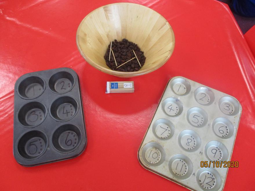 Fine motor development/ touch counting practise with raisins