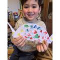 a lovely multicoloured dinosaur - great work J