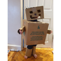 'Meet Robot He is really strong.  He likes to eat chocolate, dinosaurs and sausages.'