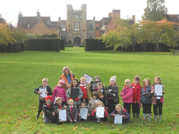 Year 2 children standing outside Coughton Court