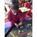 Building using pegs and craft sticks