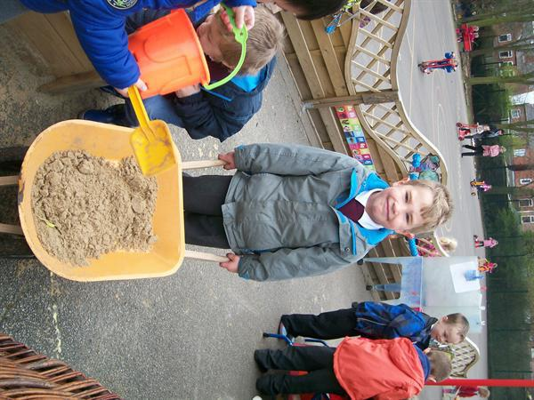 we used wheelbarrows to empty the sand pit.