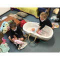 Looking after our babies in the role play area.