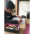 Working hard on his Maths skills!