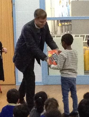 Our KS1 kindle winner reeceiving their prize