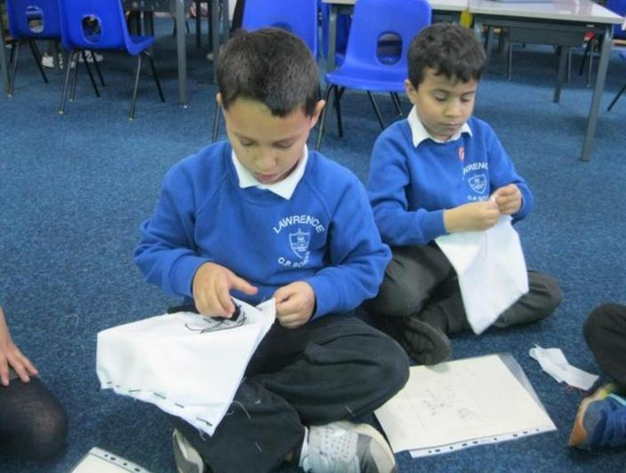 We carefully sewed the parts of our bags together.