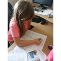 Emily doing maths.