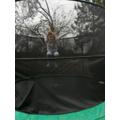 Emily enjoying time on her trampoline.