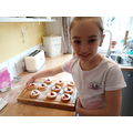 Making biscuits for her Brownie baking badge