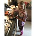Leona making a chocolate cake.