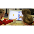 Year 4 working as team when coding using Scratch