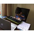Daniel on his keyboard.