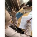 Ellie doing her maths.