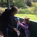 Forest School - being given a collection bag.
