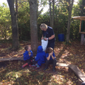 Forest School - putting our leaves into the bag.