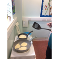 Cooking the pancakes.